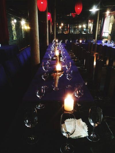 Illuminated tea light candles on table in restaurant