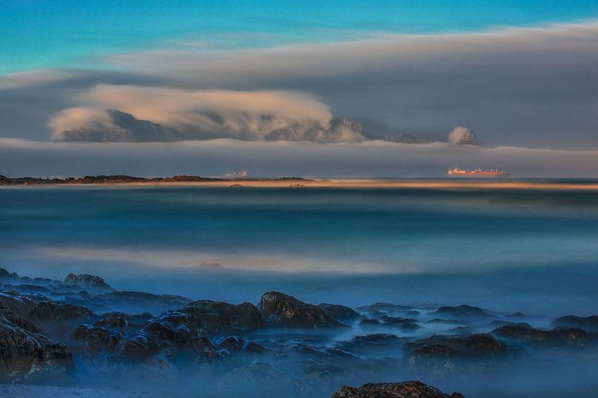 Table Mountain Table Mountain Sky Cloud - Sky Sea Water Scenics - Nature Rock Non-urban Scene Outdoors Single Boat Fog
