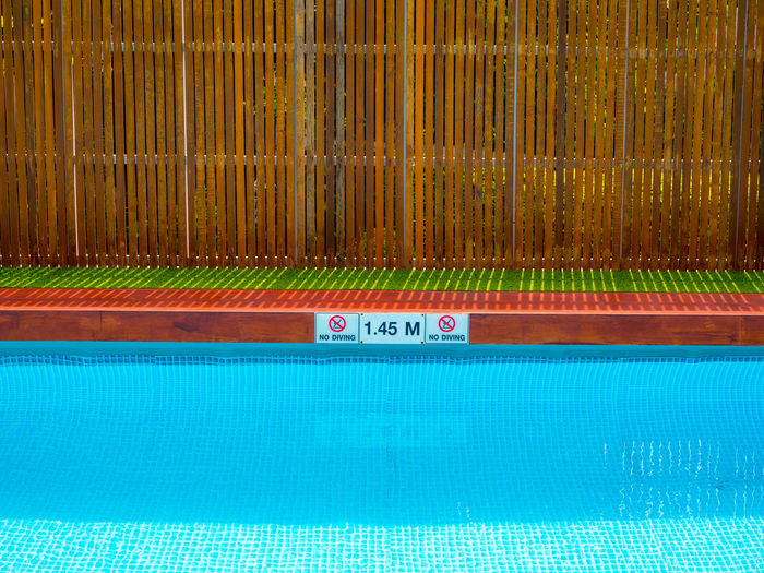 Swimming pool with text in water