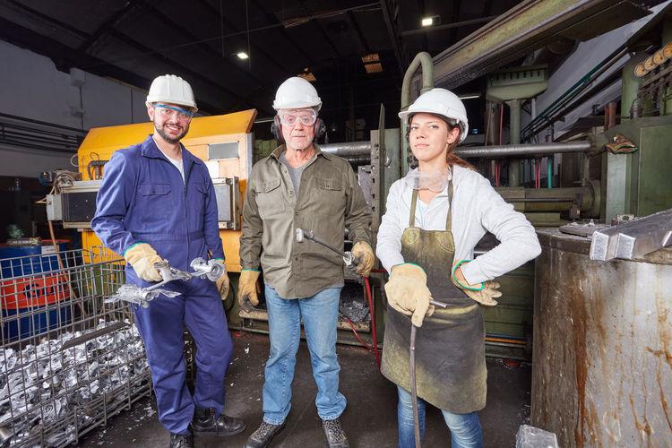 Portrait of workers standing in factory