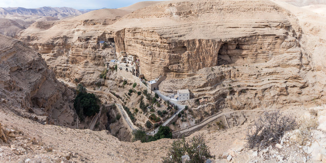 Near Mitzpe Yeriho, Israel, November 25, 2017 : The monastery of St. George Hosevit (Mar Jaris) in Wadi Kelt near Mitzpe Yeriho in Israel Ancient Architecture Christianity Church Cross Desert Greek Jesus Christ Mar Jaris Monastery Palestine St. George Travel Wadi Kelt Canyon Caves Culture Day Israel Landmark Mountain Oasis Orthodox Religion Tourism
