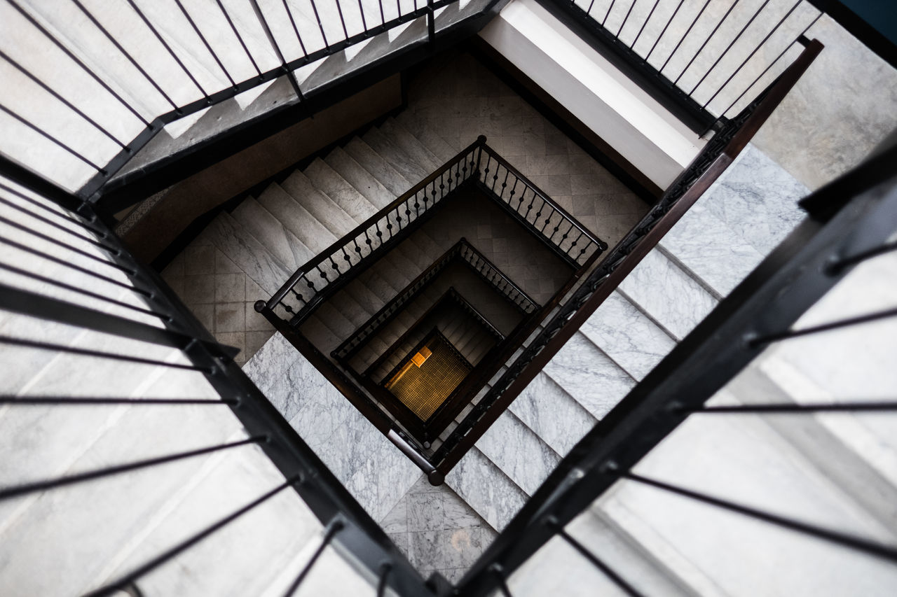 architecture, built structure, no people, low angle view, staircase, railing, day, steps and staircases, indoors, pattern, metal, building, shape, full frame, repetition, design, backgrounds, wall - building feature, ceiling, directly below
