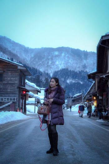 She is happy Travel Photography Japan Shirakawago Winter Young Adult Adult Young Women Cold Temperature Mountain One Person Warm Clothing Clothing Women Nature Beauty Snow Architecture Beautiful People Mountain Range Standing City Beautiful Woman Outdoors