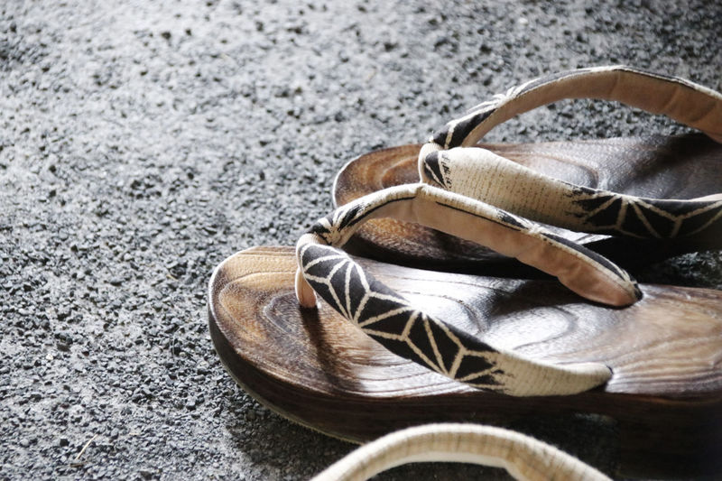 Close-up of slippers on land