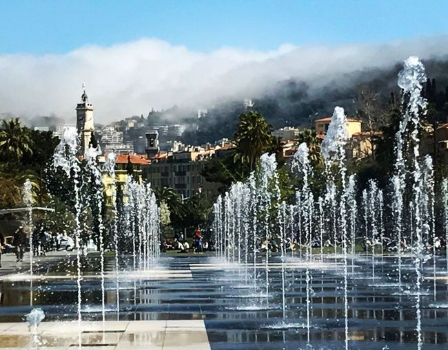 Neighborhood Map Apollo Fountains Nice France Water Architecture Mountain Cloud - Sky Sky Outdoors Building Exterior Built Structure Day Tree No People Nature Spraying City
