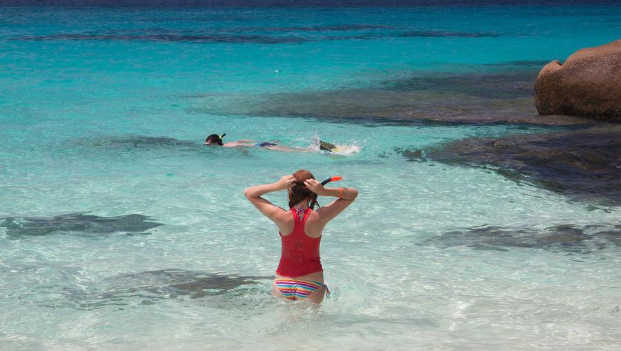 Full length of woman in bikini on swimming pool