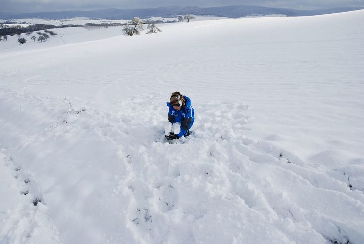 Full length of child on snow on land