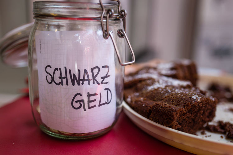 Schwarz-Geld-Glas (Dirty Money) and a chocolate cake Black Bonn Cake Chocolate Coins Dirty Dirty Money Donation Germany Glass Government Illegal Illegal Income Income Income Tax Money Shop Tax Taxes