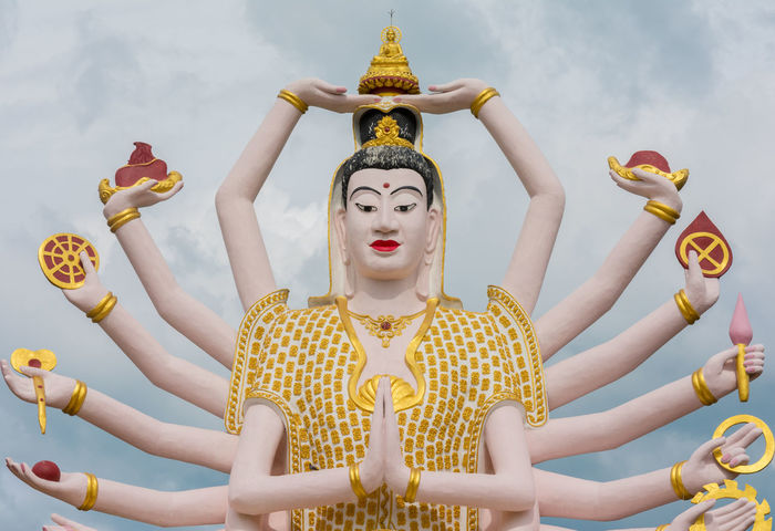 Statue at Big Buddha area in Wat Plai Laem, Koh Samui,Thailand Arms BIG Buddha Buddhism Culture Giant God Gold Colored Ko Samui Koh Samui Landmarks Place Of Worship Religion Religions Religious  Sky Spirituality Statue Thai Travel Wat Plai Laem