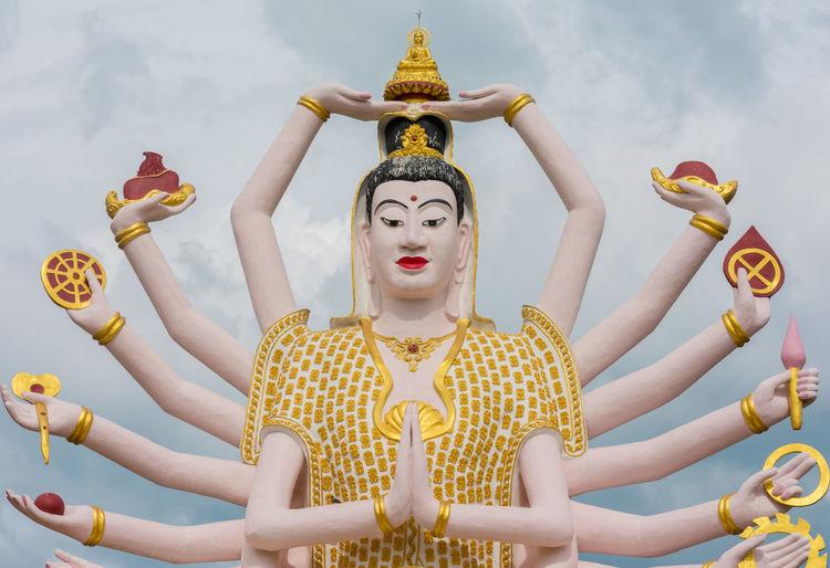 Statue at Big Buddha area in Wat Plai Laem, Koh Samui,Thailand Arms BIG Buddha Buddhism Culture Giant God Gold Colored Ko Samui Koh Samui Landmarks Place Of Worship Religion Religions Religious  Sky Spirituality Statue Thai Travel Wat Plai Laem