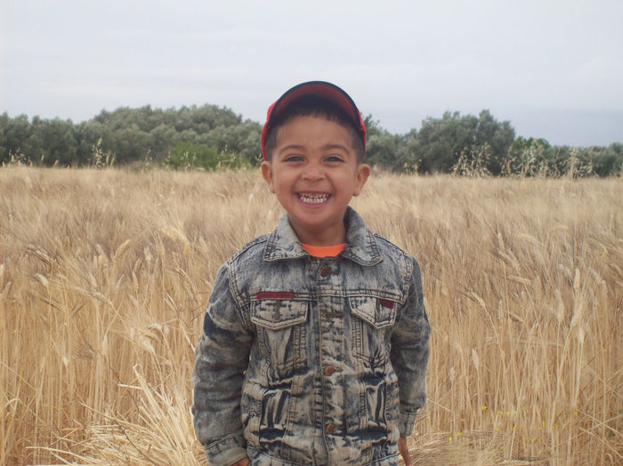 Wonderful nature at the time of harvest and the smile of the child expresses the wonderful photo