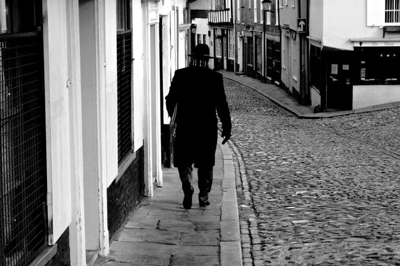 The Mystery Man Man Street Rear View Walking Full Length One Person Real People Built Structure Architecture Men Day Building Exterior Outdoors Lifestyles Streetphotography Streetphoto_bw Cobbled Streets Cobblestones Medieval Architecture Tudor Tudor Buildings