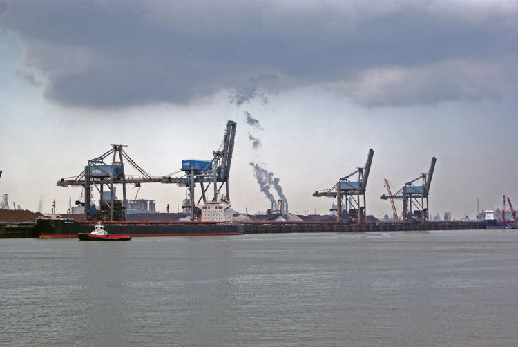 Architecture Cargo Container Cloud - Sky Commercial Dock Crane Crane - Construction Machinery Day Factory Freight Transportation Harbor Haven Industry Manufacturing Equipment Nautical Vessel No People Outdoors Rotterdam Harbor Sea Shipping  Shipyard Sky Transportation Water Waterfront