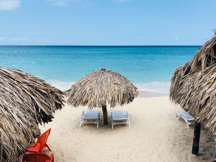 Paradise on earth - Isla Baru Lonely Beach Still Life Romantic Beach Cartagena Colombia Isla Baru Sea Water Beach Land Sky Horizon Over Water Horizon Beauty In Nature Sand Scenics - Nature Thatched Roof Nature Day Roof Parasol Beach Umbrella Umbrella Tranquil Scene Outdoors Tranquility