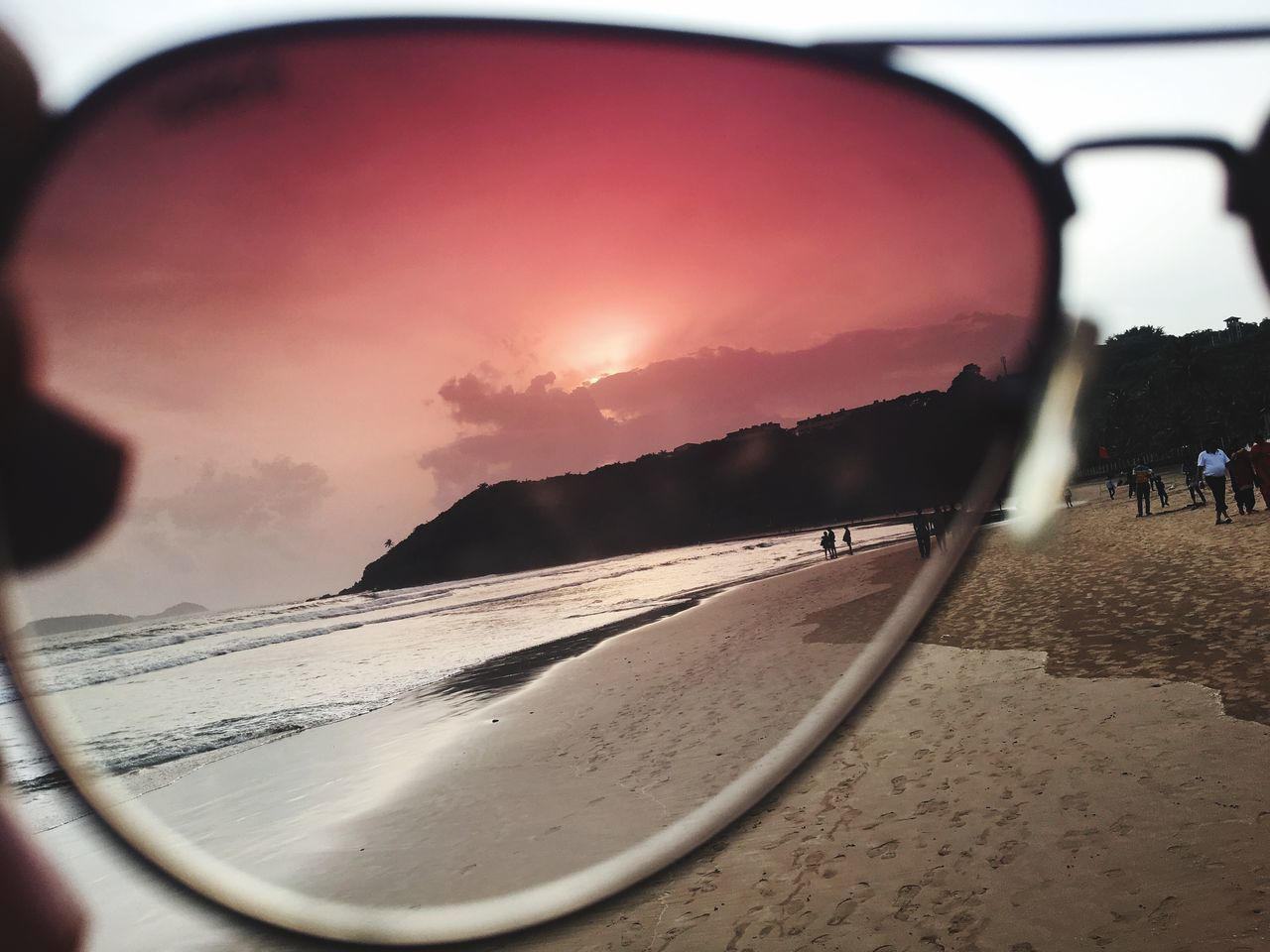 sky, beach, land, glasses, beauty in nature, sunset, sand, reflection, water, sea, sunglasses, nature, incidental people, close-up, scenics - nature, tranquility, tranquil scene, glass - material, fashion, outdoors, personal accessory