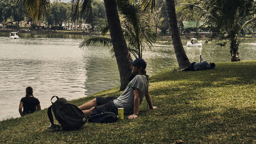 Casual Clothing Lake View Landscape Lumpini Park Relaxation Sitting Togetherness Tranquil Lake Tranquil Life Tranquil Scene Tranquility Two People