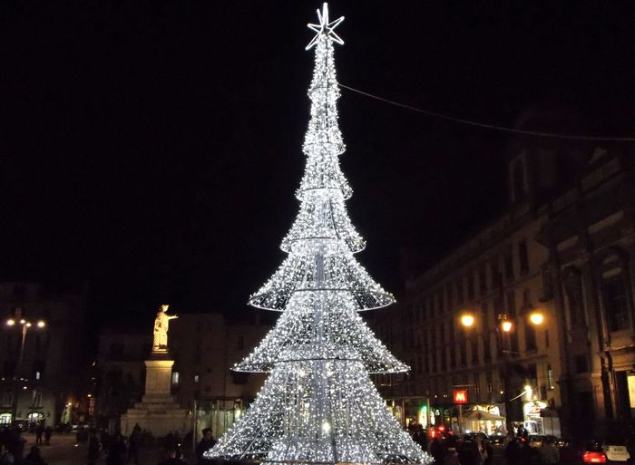 Christmas Celebration Night Decoration Christmas Decoration christmas tree Illuminated Holiday Celebration Event Architecture Christmas Lights Building Exterior Holiday - Event Sky Tree Topper Ornament Tree Christmas Ornament Outdoors No People Light Christmas Market Piazza Dante Albero Di Natale Piazza