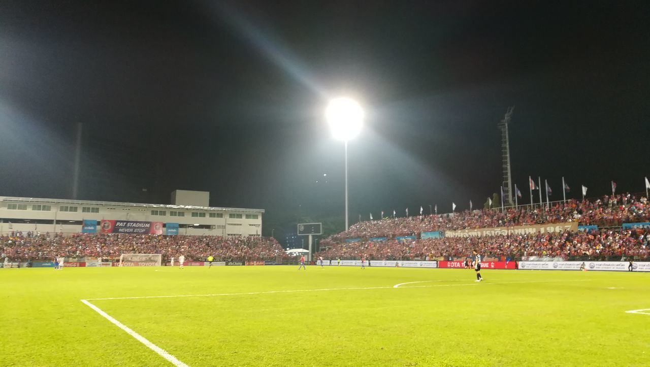 stadium, soccer, sport, grass, night, soccer field, floodlight, spectator, playing field, floodlit, team sport, crowd, fan - enthusiast, green color, outdoors, real people, audience, competitive sport, playing, large group of people, soccer player, illuminated, sports team, sportsman, competition, teamwork, sky, people