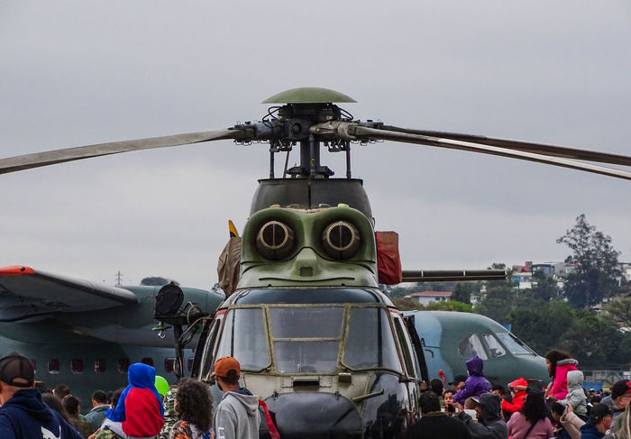 ezefer Helicopter Adult Air Vehicle Airplane Architecture City Crowd Day Group Of People Large Group Of People Leisure Activity Lifestyles Men Mode Of Transportation Nature Outdoors Real People Sky Transportation Travel Women