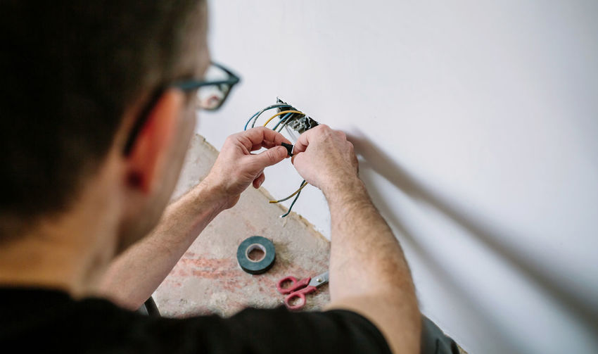 Portrait of man working on finger