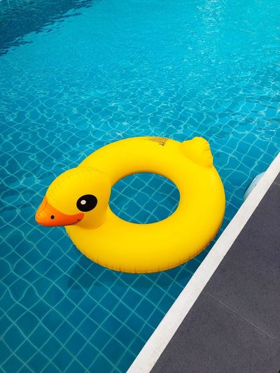 Yellow Swimming Pool Pool Water Floating On Water Floating No People Outdoors