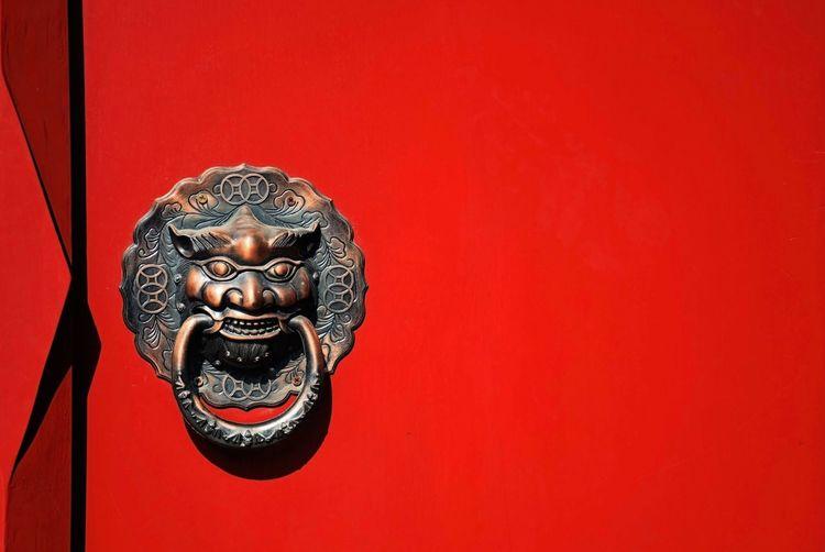 Close-up of knocker on door