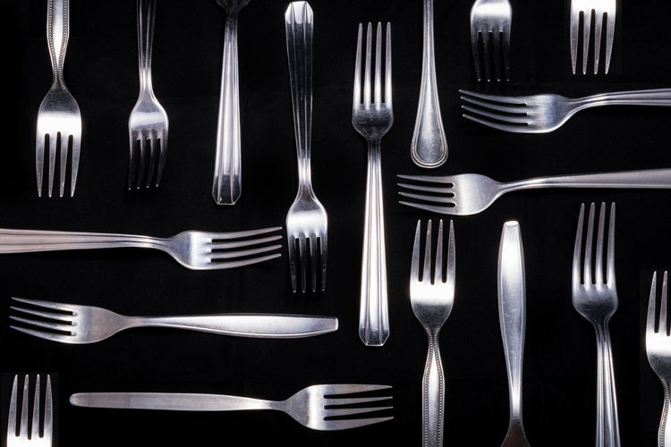 High Angle View Of Forks On Black Background