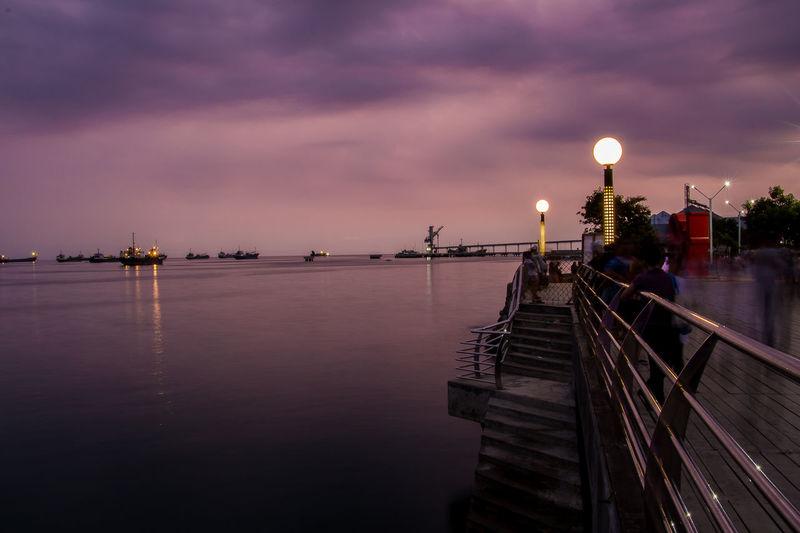 Baywalk of Naga Long Exposure Cebu Philippines Beautiful Place EyeEm Selects Astronomy City Moon Sunset Water Illuminated Sea Business Finance And Industry Industry Crescent