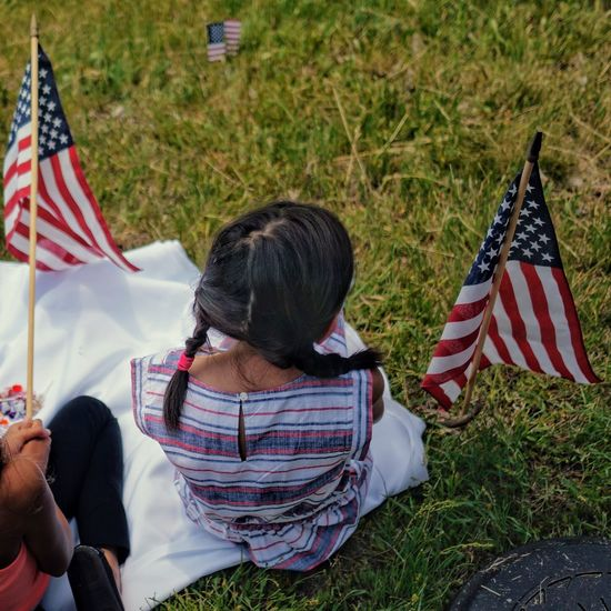 Girl with amwrican flags (reedit). Patriotism Flag Striped Freedom Child Childhood Grass Outdoors Real People Day Memorial Day Parade Pig Tails Girls