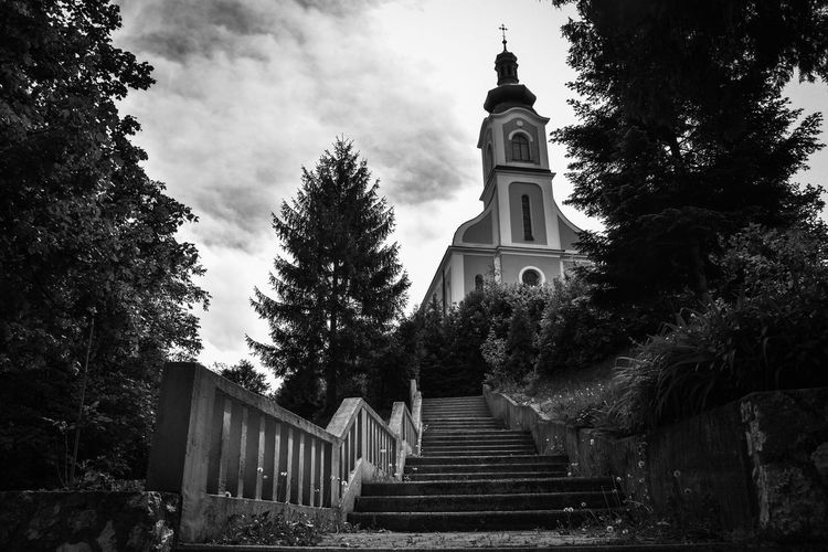 ⛪ Popular Photos Bnw Bnw_friday_eyeemchallenge Arch Architecture_collection Silence Taking Photos EyeEm Selects Alone Time Nature Pattern Exceptional Photographs Low Angle View EyeEm Blackandwhite No People Outdoors EyeEm Masterclass Nikon Master_shots Tree Sky Architecture Building Exterior Built Structure Clock Tower Tower Stairway Stairs Place Of Worship