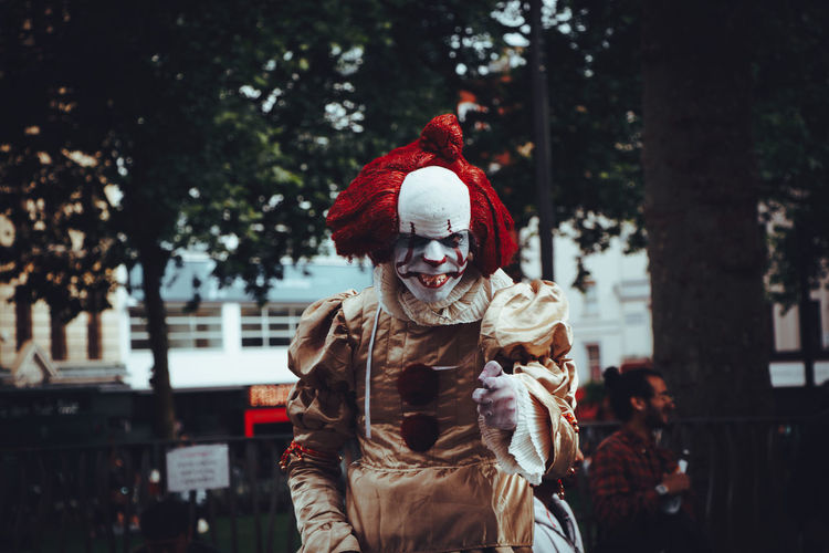 It. Stephen King. Horror movie. Costume. Street. Urban. Portrait. Focus on foreground. Clown. Cinematic. Film. Fictional Character Cinematic Film IT Redhead Book Clown Costume Day Focus On Foreground Front View Horror Movies Horror Photography Lifestyles One Person Portrait Red Color Stephen King Street Urban Waist Up The Portraitist - 2018 EyeEm Awards The Street Photographer - 2018 EyeEm Awards Be Brave