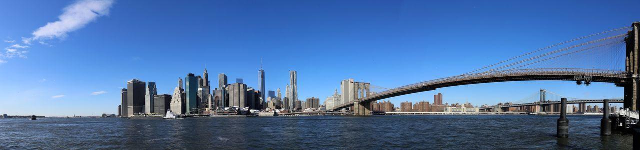 Golden gate bridge over river against clear blue sky