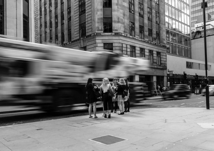 City Cityscape EyeEm EyeEm Best Edits EyeEm Best Shots EyeEmBestPics Motion Blur Architecture Black And White Black And White Photography Blurred Motion Building Exterior Built Structure City Group Of People Lifestyles Motion Outdoors Real People Speed Street Streetphotography Transportation Women