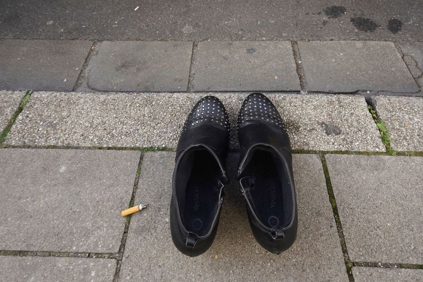 Shoe High Angle View Footpath Pair Street Black Color Directly Above Day City No People Outdoors Road Fashion Paving Stone Still Life Sidewalk Standing Close-up Slipper