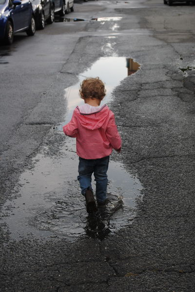 Childhood Children Only Curly Hair Happyness Rear View Reflections In The Water Rubber Boot Water My Year My View