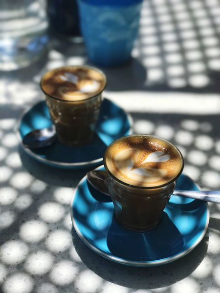 Coffee Daylight Shade Table Hot Drink Warm Drink Sun Hipster Coffee Caffeine Flat White Coffee Pattern Shadow Food And Drink Drink Coffee Table Still Life Cup Coffee - Drink Focus On Foreground Sunlight Frothy Drink Food Blue No People Close-up Coffee Cup High Angle View Mug