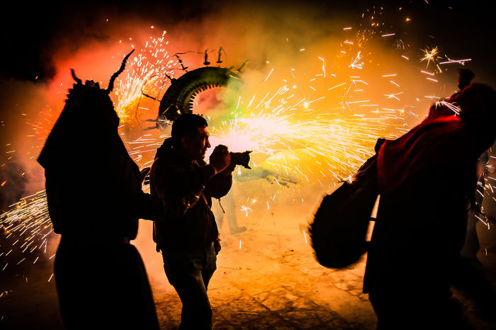 Event Arts Culture And Entertainment Burning Celebration Exploding Firework Firework - Man Made Object Firework Display Full Frame Illuminated Journalist Photography Lifestyles Long Exposure Men Motion Night Outdoors People Photagrapher Real People Silhouette Sky Sparkler Sparks Standing