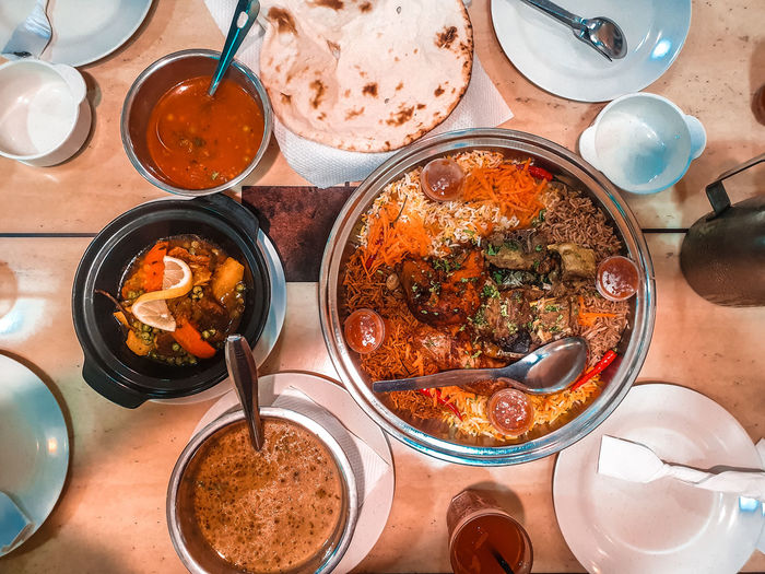 arabic cuisine Lamb Beef Chıcken Curry Rice Drink Table Directly Above Close-up Ground - Culinary Served Ready-to-eat Serving Size