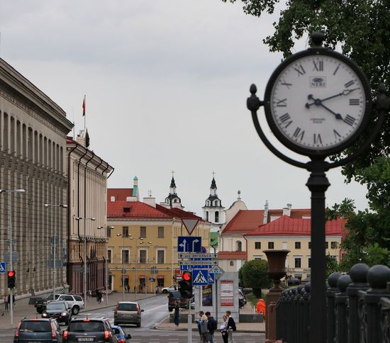 Minskcity  Minsk Citytimesquare Clocks At Street Clock Face Clock City Time Minute Hand Clock Tower City Street Street Cityscape Sky City Gate Town Square Visiting Old Town Townhouse People In The Background Place Of Interest #urbanana: The Urban Playground EyeEmNewHere