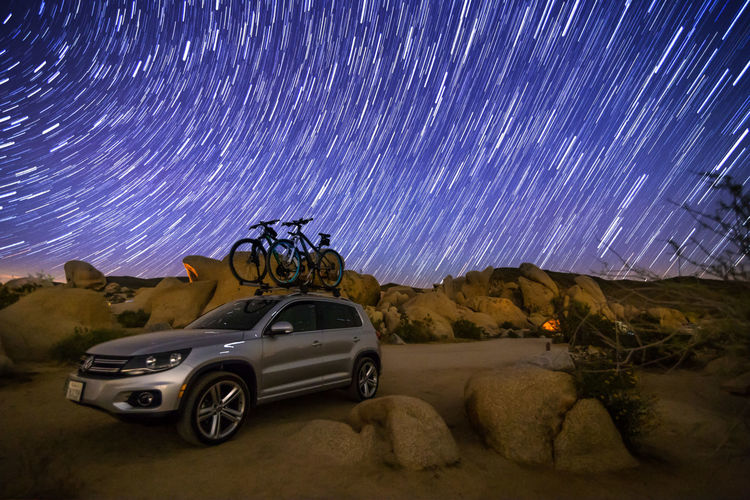 White Tank Campground, Joshua Tree National Park, California, USA Astronomy Beauty In Nature Bike Bikes Car Desert Galaxy Joshua Tree National Park Landscape Long Exposure Milky Way Mountain Mountainbike Nature Night No People Outdoors Sky Space Star - Space Star Trail VW VW Tiguan