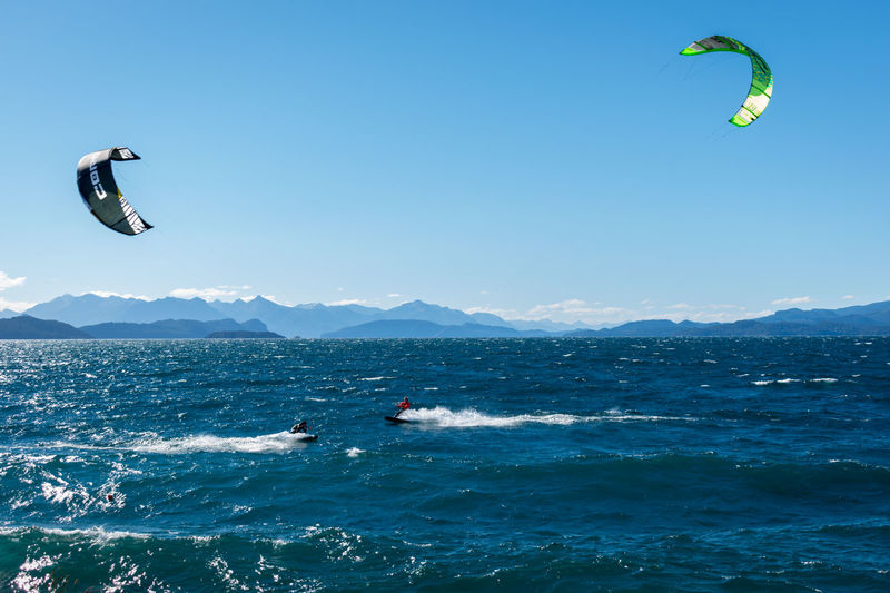 Vacation in Nahuel Huapi Lake... Sport Adventure Extreme Sports Water Sea Aquatic Sport Motion Sky Waterfront Mid-air Nature Leisure Activity Lifestyles Day Unrecognizable Person Paragliding Beauty In Nature Surfing Flying Kiteboarding Outdoors Freedom Scenics Lake Tourism