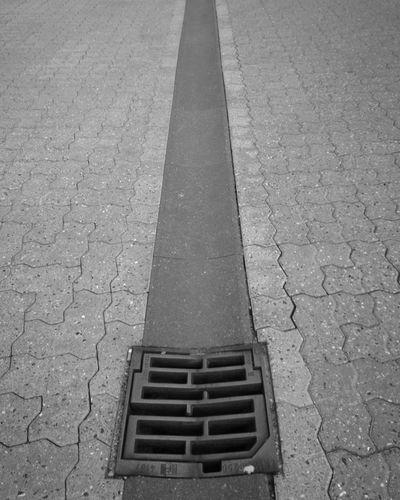 City Form Pavement Pavement Patterns Tiles Sewage Metal Grate Road Manhole  Gutter Sewer High Angle View Street Drain Paving Stone