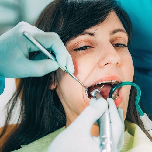 Cropped Image Of Dentist Examining Patient