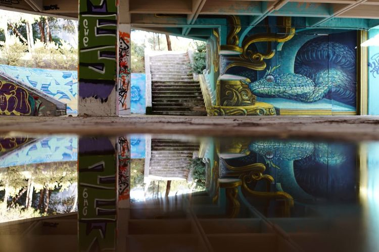Graffiti Reflections 2 / Wild Drawing Athens Street Photography Athens, Greece Streetart Color Streetart Streetartphotography Wild Drawing Urban Lifestyle Urban Photography Graffiti Art Graffiti Reflections In The Water Reflection Photography Indoors  No People Built Structure Architecture Day