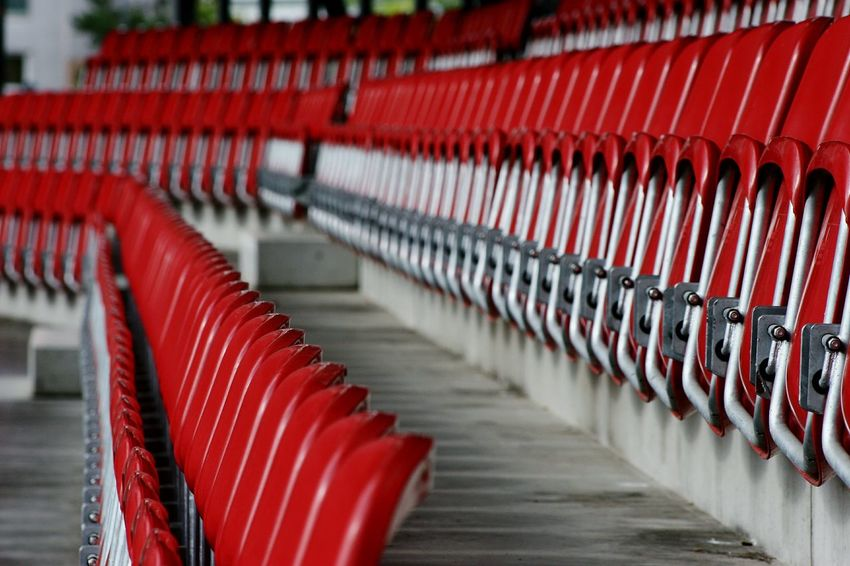 In A Row Red Repetition No People Seat Stadium Spectators Stadium Soccer Red And Gray STAND SeatsLarge Group Of Objects Seats Available Sport Backgrounds Abundance Indoors  Day Architecture Passage