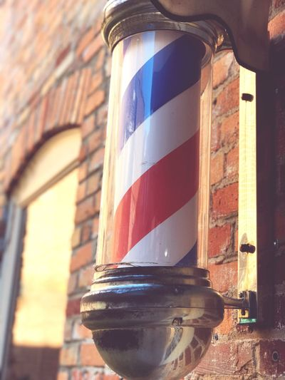 Barber Pole Architecture Building Exterior Built Structure Window No People Day Close-up Outdoors Sky Barber Pole Barber Shop Blurred Background Focus On Foreground Red White And Blue Barber Life Barber Barber Sign