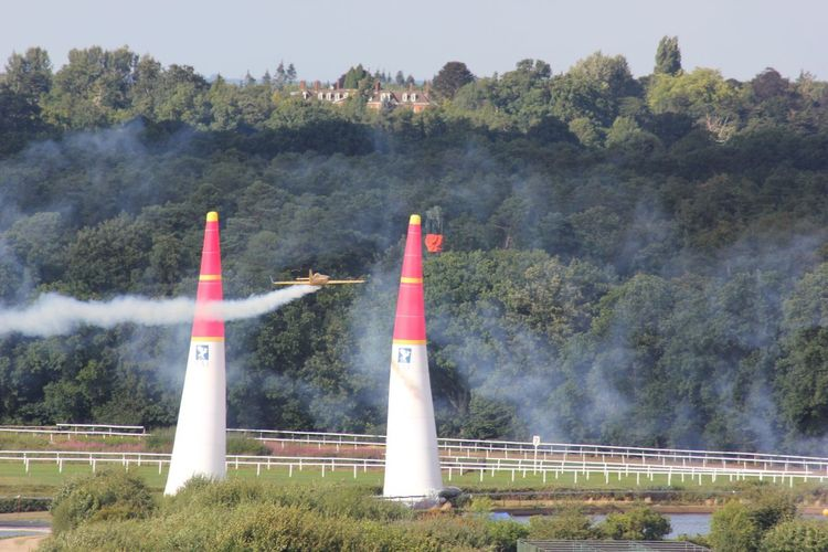 Airplane flying through bollards during race