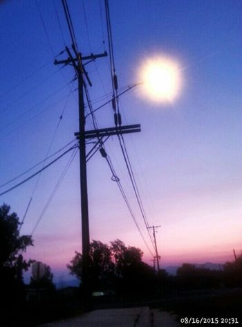 Utilities street lights, sunset, utility poles, electrical wires, high voltage, telephone wires