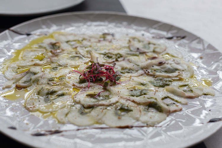 A plate of fish carpaccio.