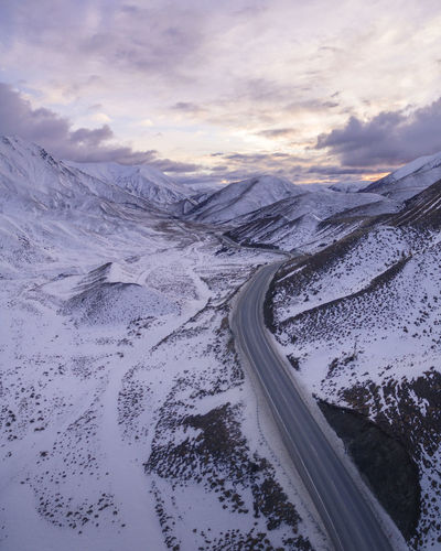Drone  Beauty In Nature Cloud - Sky Cold Temperature Day Dronephotography Environment Landscape Mountain Nature No People Non-urban Scene Outdoors Road Scenics - Nature Sky Snow Snowcapped Mountain Sunset Tranquil Scene Tranquility Transportation Winter